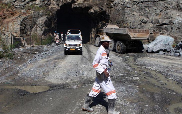 A mine worker is pictured at the Freda Rebecca gold mine in Bindura town. REUTERS/FILE
