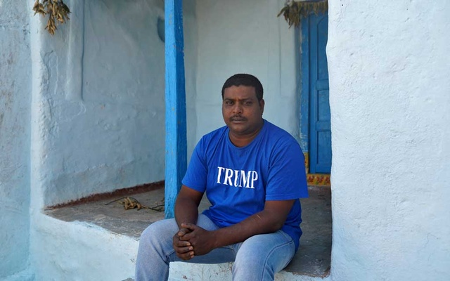 Bussa Krishna, a fan of US President Donald Trump, wears a t-shirt with the word Trump as he poses for a photograph in Konney village in the southern state of Telangana, India, Feb 14, 2020. REUTERS