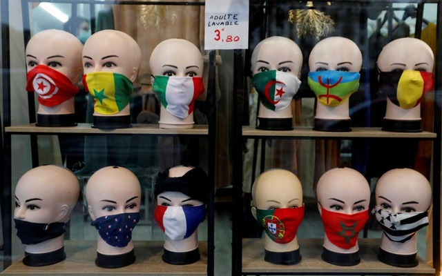 Protective face masks with flags design are seen on display in a shop in Paris, as the coronavirus disease (COVID-19) outbreak continues in France, October 13, 2020. Reuters