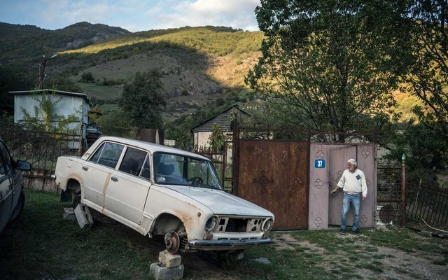 A man outside the entrance to his property in Shgharjik, Armenia, on Sunday, Oct 11, 2020. For the region's populace, the war is a continuation of decades of strife over both territory and history. Sergey Ponomarev/The New York Times