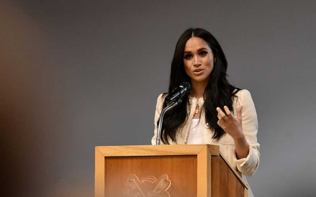 Britain's Meghan, Duchess of Sussex speaks during a school assembly as part of a visit to Robert Clack School in Essex, Britain March 6, 2020, in support of International Women's Day. REUTERS