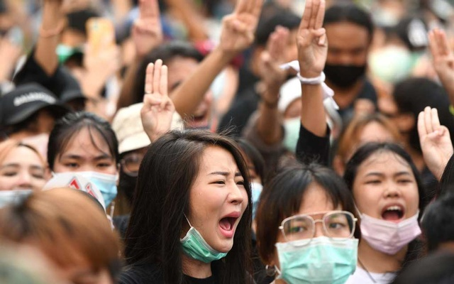 A woman reacts as pro-democracy protesters gather demanding the government to resign and to release detained leaders in Bangkok, Thailand Oct 15, 2020. REUTERS
