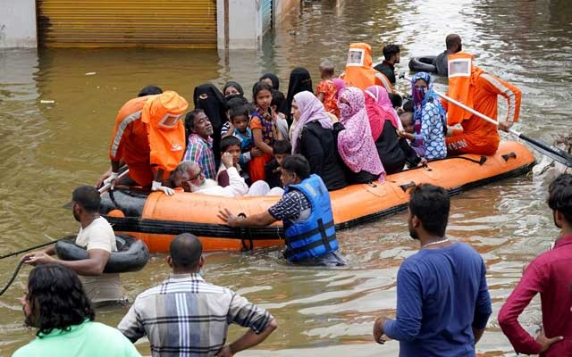 Residents are evacuated from a flooded neighbourhood after heavy rainfall in Hyderabad, the capital of the southern state of Telangana, India, October 15, 2020. Reuters