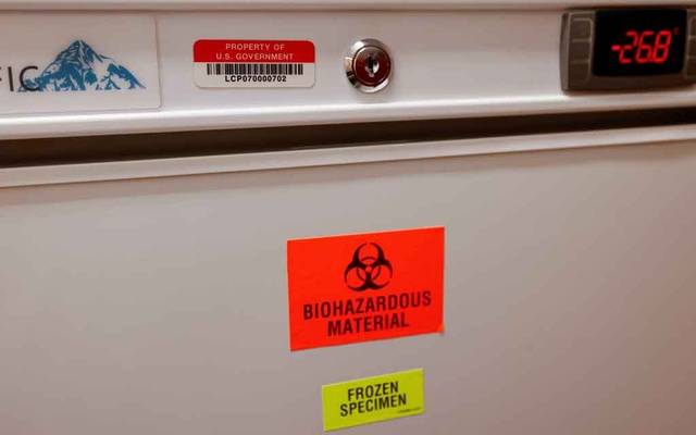 A biohazards fridge with a US Government property sticker is shown inside a trailer compound after a Phase 3 trial location of Johnson & Johnson's Janssen (COVID-19) vaccine candidate was announced in National City during the outbreak of the coronavirus disease (COVID-19) in National City, California, US, October 13, 2020. Reuters