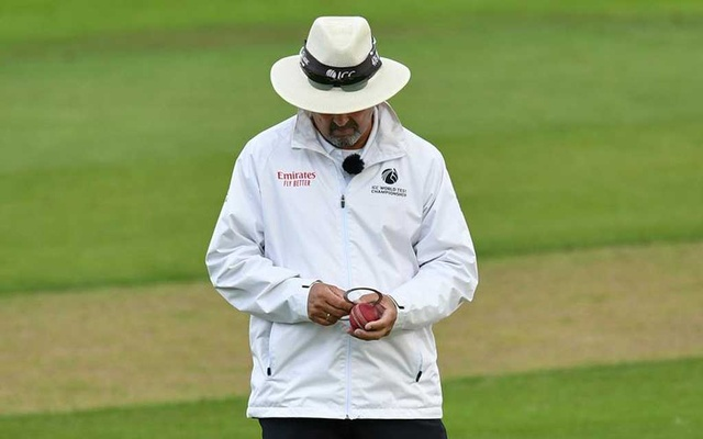 Cricket - Emirates Old Trafford, Manchester, Britain - August 6, 2020 An umpire checks the shape of the ball, as play resumes behind closed doors following the outbreak of the coronavirus disease (COVID-19) Dan Mullan/Pool via REUTERS