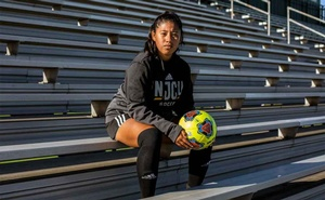 Crystal Tepale, a senior at New Jersey City University who hopes to become a lawyer, rests after soccer practice in Jersey City, N.J., on Wednesday, Oct. 14, 2020. An extraordinary demographic shift is sweeping through US university campuses as immigrants and children of immigrants become an ever-larger share of student bodies, with implications for the future of the country's work force, higher education and efforts to reduce racial and economic inequality. (Bryan Anselm/The New York Times)