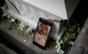 A digital photograph of jailed Filipino activist Reina Mae Nasino's three-month-old baby River, is placed beside her coffin before she is buried, in Manila North Cemetery, Philippines, October 16, 2020. Reuters