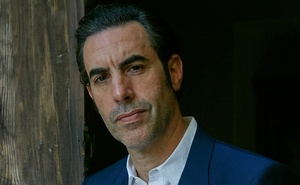 """Sacha Baron Cohen in Los Angeles on Oct. 12, 2020. Reviving his Borat character and playing the social activist Abbie Hoffman, the actor feels he """"had to ring the alarm bell and say that democracy is in peril this year."""" Baron Cohen's riotous characters have perhaps masked his dramatic abilities. (Buck Ellison/The New York Times)"""