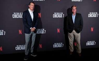 Director and writer of the movie Aaron Sorkin (R) and Scott Stuber, head of original films at Netflix, pose at a drive-in premiere for the film