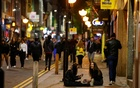 People walk and gather outside bars the night before a local lockdown amidst the spread of the coronavirus disease (COVID-19) in Liverpool, Britain Oct 13, 2020. REUTERS/FILE