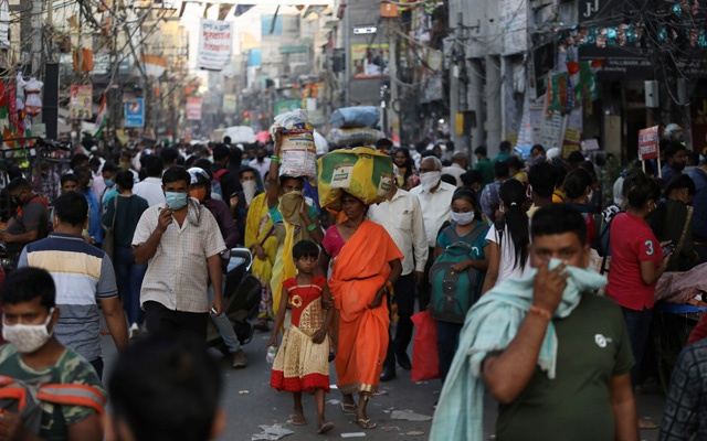 People are seen at a market amidst the spread of the coronavirus disease (COVID-19), in the old quarters of Delhi, Oct 19, 2020. REUTERS