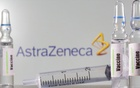 A test tube labelled vaccine is seen in front of AstraZeneca logo in this illustration taken, September 9, 2020. REUTERS