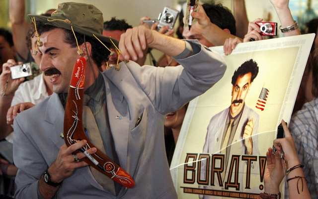 British actor Sacha Baron Cohen, in character as a Kazakh TV reporter known as 'Borat', holds a boomerang as he mingles with fans in Sydney November 13, 2006 during the Australian premiere of his film