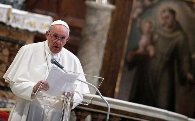 Pope Francis speaks during an inter-religious prayer service for peace along with other religious representatives in the Basilica of Santa Maria in Aracoeli, a church on top of Rome's Capitoline Hill, in Rome, Italy, Oct 20, 2020. REUTERS
