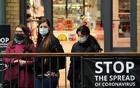 People wearing protective face masks look over balcony in Covent Garden as the coronavirus disease (COVID-19) outbreak continues in London, Britain October 18, 2020. REUTERS
