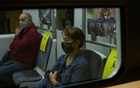 Commuters wearing protective face masks are seen on board a train, amid the spread of the coronavirus disease (COVID-19), in Athens, Greece, Oct 24, 2020. REUTERS