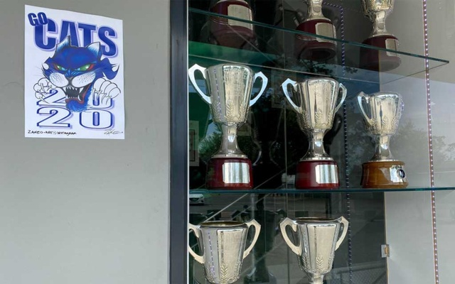 A window containing Australian Football League championship trophies won by the Geelong Cats at Kardinia Park, home stadium of the Cats in Geelong, Australia Oct 23, 2020. REUTERS