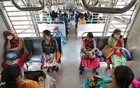 Women wearing protective face masks commute in a suburban train after authorities resumed the train services for women passengers during non-peak hours, amidst the coronavirus disease (COVID-19) outbreak, in Mumbai, October 21, 2020. REUTERS/Niharika Kulkarni