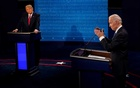 Democratic presidential candidate former Vice President Joe Biden answers a question as President Donald Trump listens during the second and final presidential debate at the Curb Event Center at Belmont University in Nashville, Tennessee, US, October 22, 2020. Morry Gash/Pool via REUTERS