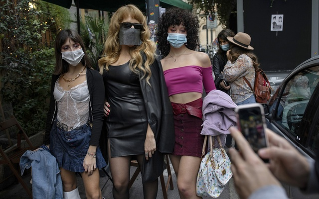 Myss Keto, second from left, the Italian rapper, performance artist and LGBTQ icon, strikes a pose with fans in Milan, Oct 10, 2020. The New York Times