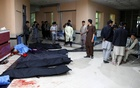 Afghan men look for their relatives at a hospital after a suicide bombing in Kabul, Afghanistan October 24, 2020. REUTERS/Mohammad Ismail