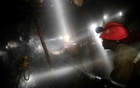 Mine workers employed at Sibanye Gold's Masimthembe shaft operate a drill in Westonaria, South Africa, April 3, 2017. REUTERS/Mike Hutchings