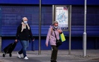People wearing protective masks are seen amid the outbreak of the coronavirus disease (COVID-19), in Coventry, Britain October 25, 2020. REUTERS/Andrew Couldridge