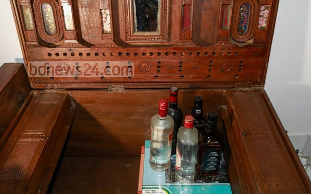 Bottles of liquor were seized from the home of MP Haji Mohammad Selim's son Erfan Selim, Oct 26, 2020.
