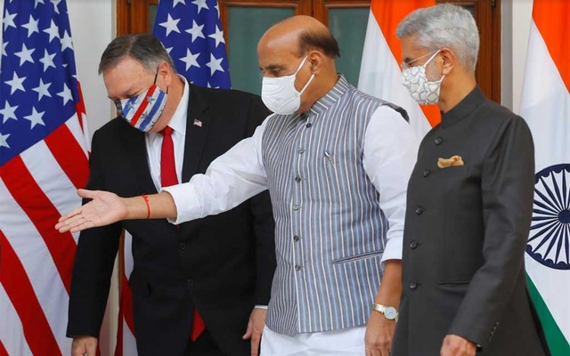 India's Defence Minister Rajnath Singh gestures to show the way to US Secretary of State Mike Pompeo, after they posed for a picture with India's Foreign Minister Subrahmanyam Jaishankar and US Defence Secretary Mark Esper (not pictured) during a photo opportunity ahead of their meeting at Hyderabad House in New Delhi, India, Oct 27, 2020. REUTERS