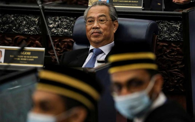 Malaysia's Prime Minister Muhyiddin Yassin reacts during a session of the lower house of parliament, in Kuala Lumpur, Malaysia July 13, 2020. REUTERS/