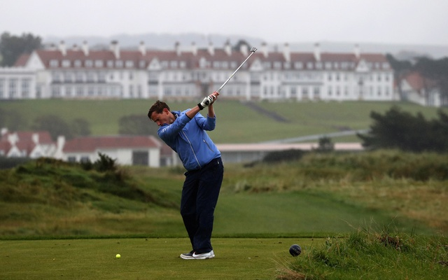A golfer plays towards the hotel on the Ailsa Championship Course at the Trump Turnberry Golf Resort in Turnberry, Scotland, Britain October 3, 2020. REUTERS