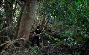 Paranormal investigator Charles Goh looks for signs of former settlements in a jungle near Yishun, in Singapore Oct 15, 2020. REUTERS