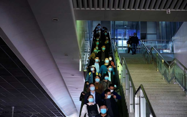 People wearing face masks amid the global outbreak of the coronavirus disease (COVID-19) are seen at Shanghai Hongqiao Railway Station in Shanghai, China October 26, 2020. Reuters