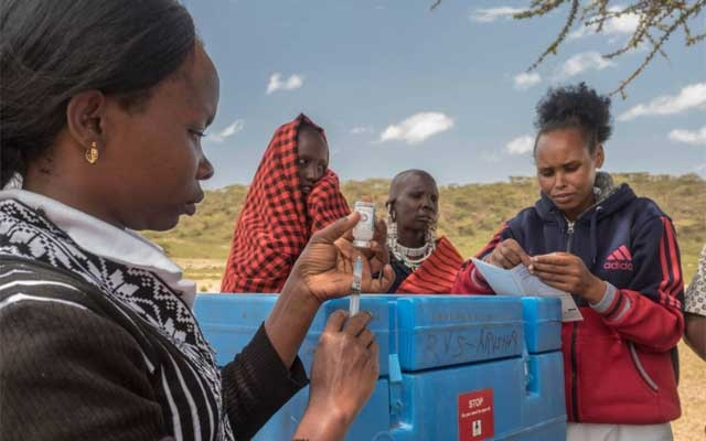 At an outreach post, Maasai people in the mountains far away from any health centre are vaccinated and recorded in the Electronic Immunisation Register by Dr Shemaghembe Bakeri, in the Ngorongoro conservation area, Kiragarieni, Tanzania, on Oct 4, 2018. Reuters