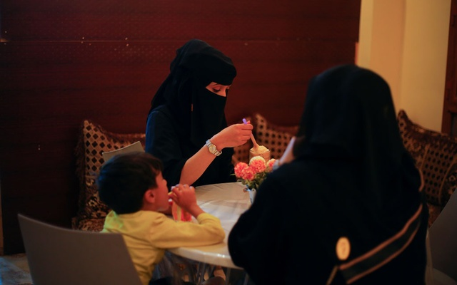 Women and a boy sit in the only all-female internet cafe in Marib, Yemen October 13, 2020. REUTERS