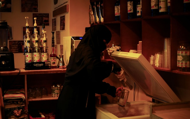Um Feras, the owner of the only all-female internet cafe in Yemen's Marib province prepares a beverage at her cafe in Marib, Yemen October 13, 2020. REUTERS