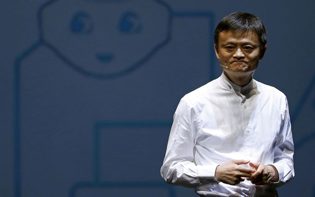 Jack Ma, founder and executive chairman of China's Alibaba Group, speaks in front of a picture of SoftBank's human-like robot named 'pepper' during a news conference in Chiba, Japan, June 18, 2015. Reuters
