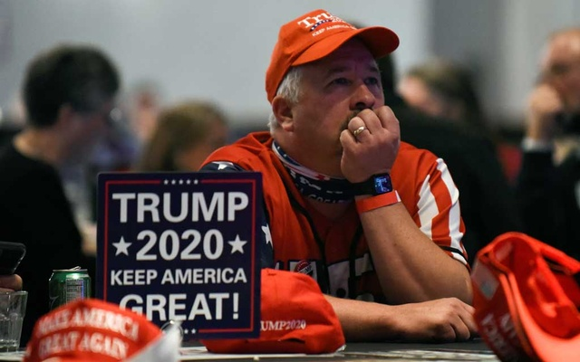 US President Donald Trump supporter watches the 2020 US presidential election results come in on Fox News at the DoubleTree Hotel in Bloomington, Minnesota, US November 3, 2020. REUTERS