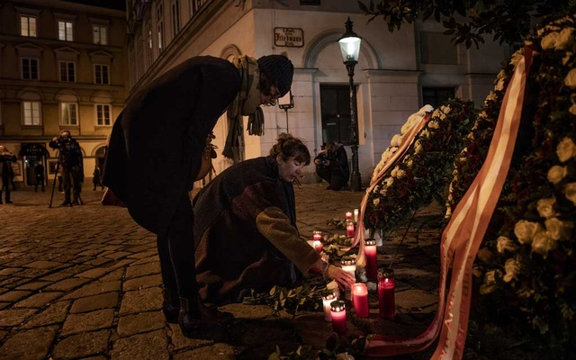 Mourners visit a makeshift memorial in central Vienna, where a mass shooting left at least 4 dead and 22 wounded the night before, on Tuesday, Nov 3, 2020. The attacker, who was killed by police, was a 20-year-old Austrian citizen who had once been imprisoned for attempting to travel to Syria to join the Islamic State group, authorities said on Tuesday. (Laetitia Vancon/The New York Times)
