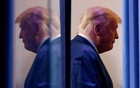 US President Donald Trump is reflected as he departs after speaking about the 2020 US presidential election results in the Brady Press Briefing Room at the White House in Washington, US, Nov 5, 2020. REUTERS