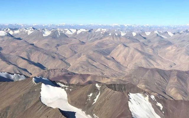 FILE PHOTO: Snow-covered mountain range is seen from a passenger airplane in Ladakh region September 14, 2020. REUTERS/Danish Siddiqui/File Photo