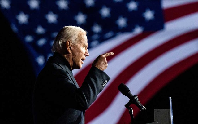 FILE - Democratic presidential nominee Joe Biden speaks at a campaign event in Detroit, Oct 31, 2020. Biden has spent his career devoted to institutions and relationships. And those are the tools he will rely on to govern a fractured nation. (Erin Schaff/The New York Times)