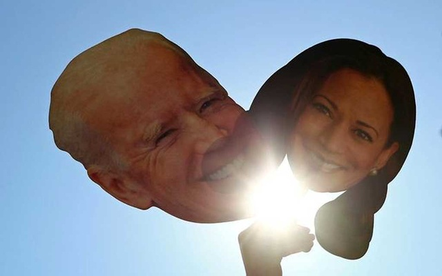 Cardboard cut-outs of Joe Biden and Kamala Harris are seen as people celebrate at Black Lives Matter Plaza after media announced that Democratic US presidential nominee Joe Biden has won the 2020 US presidential election, near the White House in Washington, US November 7, 2020. REUTERS/Tom Brenner