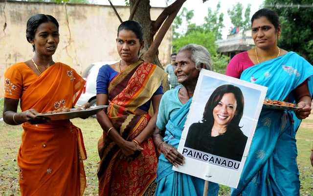 Women gather to celebrate the victory of US Vice President-elect Kamala Harris in Painganadu near the village of Thulasendrapuram, where Harris' maternal grandfather was born and grew up, in the southern state of Tamil Nadu, India, November 8, 2020. REUTERS