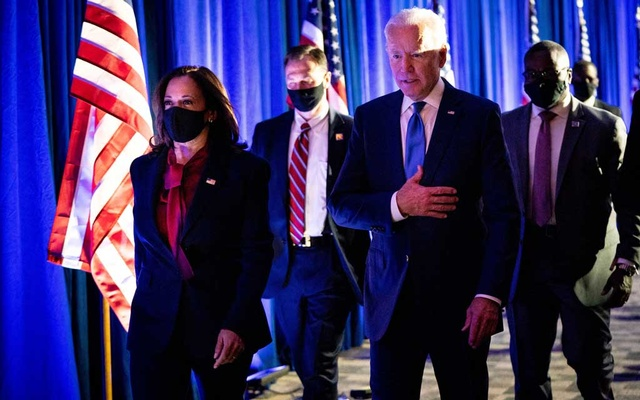 Joe Biden, then the Democratic presidential nominee, alongside his running mate Sen Kamala Harris (D-Calif), leave the stage after giving an address in Wilmington, Del, Nov 6, 2020. Erin Schaff/The New York Times