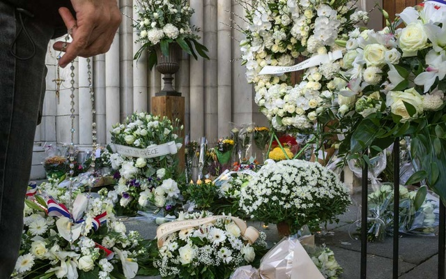 "FILE -- A makeshift memorial at the Notre-Dame basilica the day after a Tunisian migrant killed three people there with a knife before lunging at police officers while yelling, ""Allahu akbar,"" in Nice, France, Oct 30, 2020. Austria and France both suffered deadly attacks in recent weeks and their responses offer a glimpse of the political shape-shifting around Europe's complex relationship with Islam. (Mauricio Lima/The New York Times)"