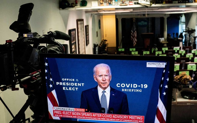President-elect Joe Biden appears on a TV screen at the White House briefing room in Washington, Nov 9, 2020, as he speaks in Wilmington, Del, about the coronavirus. Biden has yet to receive a presidential daily briefing, and it was unclear whether his team would have access to classified information, the most important pipeline for them to learn about the threats facing the United States. (Anna Moneymaker/The New York Times)