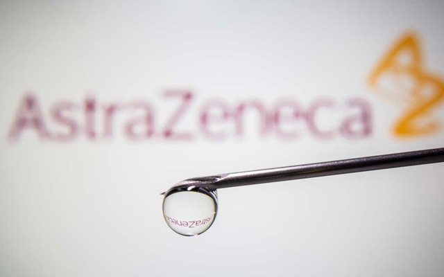 AstraZeneca's logo is reflected in a drop on a syringe needle in this illustration taken November 9, 2020. Reuters