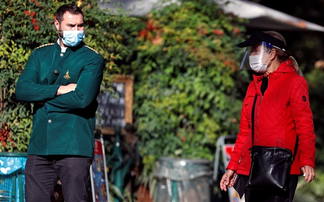 People wear protective face masks, as the spread of the coronavirus disease (COVID-19) continues, in Rome, Italy November 10, 2020. REUTERS
