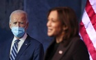US President-elect Joe Biden listens as Vice President-elect Kamala Harris speaks about protecting the Affordable Care Act (ACA) as she speaks to reporters about their